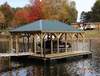 Covered Boat Slip with Lift on Waterfront Lot